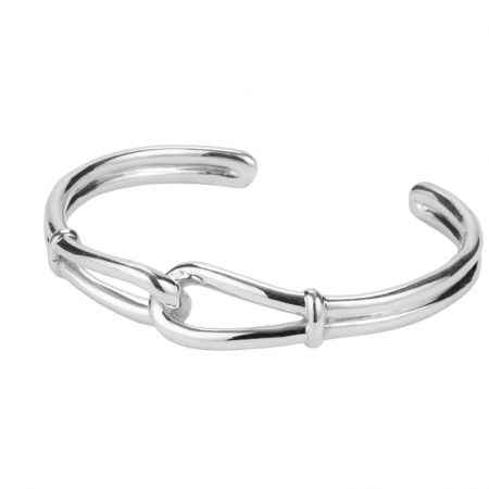 Interlocking silver stirrup bangle