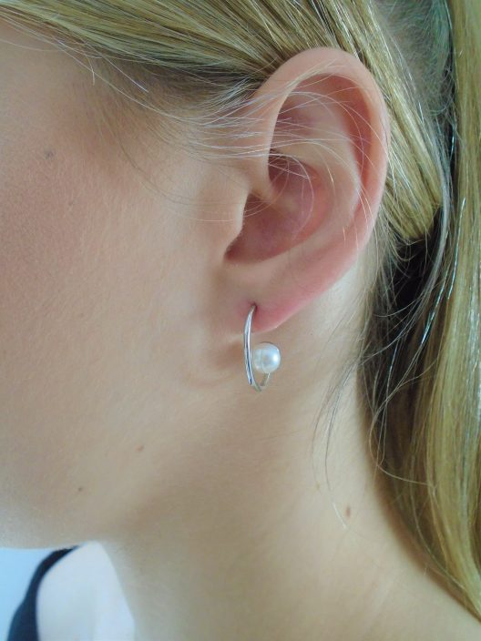 Pearl on silver loop lobe