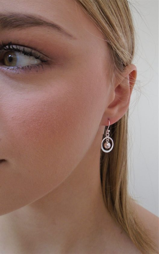 circle and bead drop earrings on model