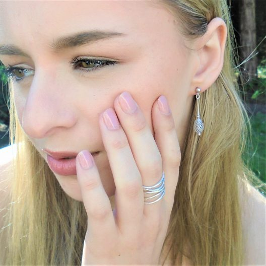 Model with multi wave ring and filigree earrings